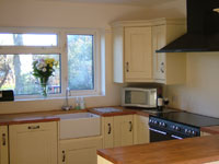 Our kitchen with a range cooker, belfast sink and microwave